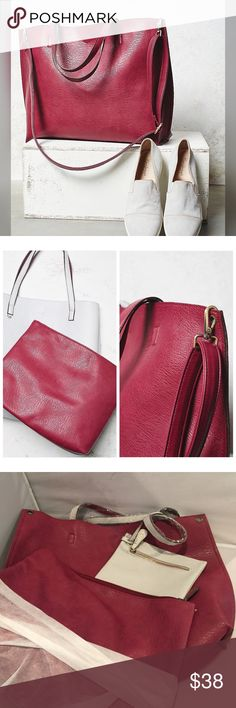 """NWT Free People Reversible Slouchy Vegan tote Purple-red/white. This reversible, vegan leather tote features an elegant shape and large removable zipper pouch. perfect for storing a laptop, tablet, or other odds and ends. Small blemish in leather (seen in last photo) Attached small zipper pouch makes an ideal coin purse! Removable and adjustable long leather strap. Magnetic closure. 100% Vegan Leather, Depth: 13.5"""" = 34.29 cm 