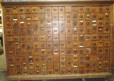 160 drawer vintage oak cabinet. Standing 77 tall, 106 long by 19 deep. Each drawer is 5 3/8 tall, 4 3/4 wide by 15 long. This piece does show