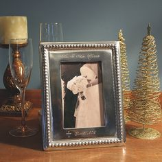 The beaded frame features the couples name, wedding date, and a budded cross accent. Ideal for newlyweds, or for those celebrating another year together, this fabulous keepsake gift will be cherished for years to come.