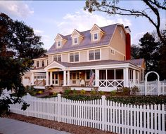 Dutch Colonial House Plans Architecture and Exterior: Beautiful Style Dutch Colonial House Plans Applied Traditional Gardening With Traditional White Fence View From Street At EVening