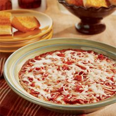 Here's a crowd pleasing dip to serve at your next party...it has all the great flavors of pizza easily made into a hot and cheesy dip. What could be better?