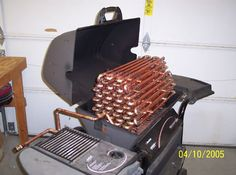 Top 10 Coolest BBQ Grills (And Then Some!) accept this is a hillbilly pool heater! lolz