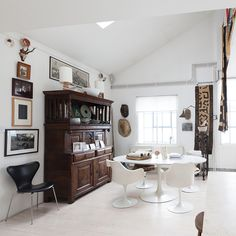 eclectic dining area with wooden cabinet and contemporary white dining table