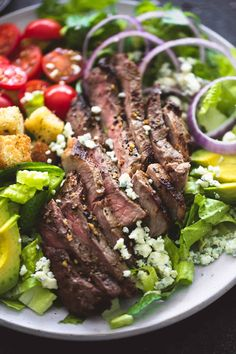 Perfectly seasoned grilled steak, homemade blue cheese dressing AND croutons, plus red onion, avocado, and tomatoes take this black n' blue grilled steak salad to a whole new level of delicious. Flank Steak Salad, Grilled Steak Salad, Meat Salad, Grilled Steak Recipes, Grilled Meat, Soup And Salad, Cobb Salad, Beef Recipes, Healthy Recipes