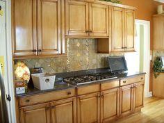 umber glaze over pickled oak cabinets