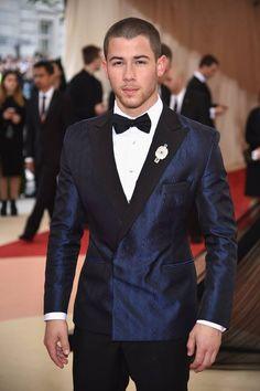 Nick Jonas at the 2016 Met Gala wearing bespoke Topman suit.