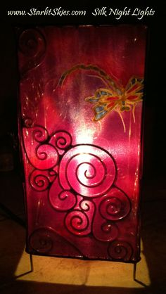 We are now making lamps. I love the Spirals on this frame. I think I want to make a top of Spirals so it projects onto the ceiling.   Hand Painted Silk Dragonfly Table Lamp. We are also making plug in wall night lights with our hand painted Silks... Coming soon! www.StarlitSkies.com