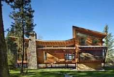 Finne Architects have designed the Mazama House, located in the Methow Valley of Washington State. Also designed by Finne Architects are some of the custom furniture pieces shown throughout the house.  modern organic wood stone metal roofline clerestory windows