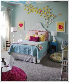 Love the wall color, the elephant lamp, and the floor cushion. might end up putting carpet in her room at some point too. love the bed, i could figure out a toddler/twin size version of it.