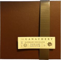 Opening a box of chocolates from The Ganachery at Disney Springs