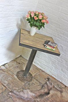 Heavy Pedestal Base and reclaimed wood tabletop.  Plough disc for pedestal base.