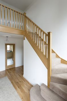 This elegant twisted spindle staircase was expertly handcrafted by master carpenters and features our Eden spindles and Cherwell newel posts. Wooden Staircase Railing, Outdoor Stair Railing, House Staircase, Oak Stairs, Wooden Stairs, Banisters, Stair Bannister Ideas, Railing Design, Staircase Design