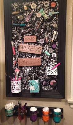 Magnetic makeup board and painted mason jar organizer.