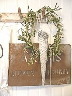 paper cone with simple greenery wreath. sheet music with glitter