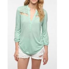 Cut out top Super cute cut out top. 3/4 sleeves in a beautiful light teal color. Is a tad longer in the back than the front, and the Lacey look on top with cut outs adds the perfect amount of cuteness and sexiness! Worn twice, just doesn't fit anymore Urban Outfitters Tops Blouses