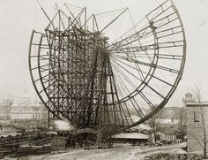 Building the very first Ferris Wheel.  The original Ferris Wheel was designed and constructed by George Washington Gale Ferris, Jr. as a landmark for the 1893 World's Columbian Exposition in Chicago. The term Ferris wheel later came to be used generically for all such structures.