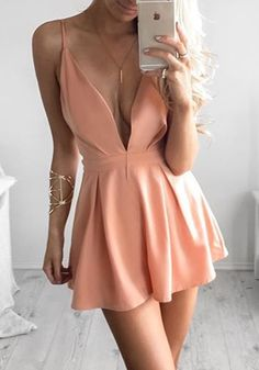 With this stunning apricot peach plunge skater dress, it's always easy to make a dramatic entrance at a party or club.