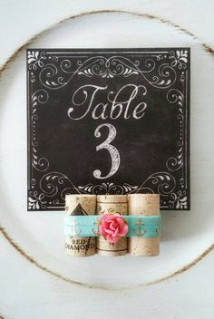 Check out this item in my Etsy shop https://www.etsy.com/listing/269653009/wine-cork-table-number-holders-coast