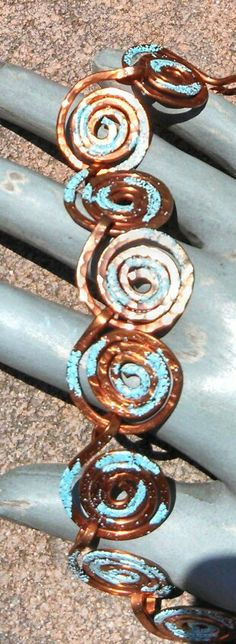 """Copper swirled 14 gauge hammer textured bracelet.  Highlighted with turquoise Iced enamel.  Fits 7-7 1/4"""" wrist.  $37.50 plus shipping."""