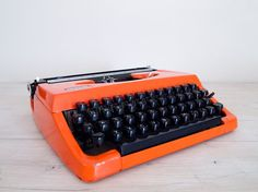 reserved - vintage burnt orange brother 210 japanese typewriter with hard case, made in japan on Etsy, Sold