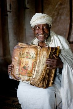 Ethiopian priest at Lake Tana with an 800yr old goatskin bible.