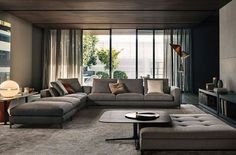 Minotti Living Room Sectional | Darker rooms are always a good choice for the winter season | www.bocadolobo.com/ #inspirationideas #luxurybrands #luxury #luxurious #luxuryfurniture #interiordesign