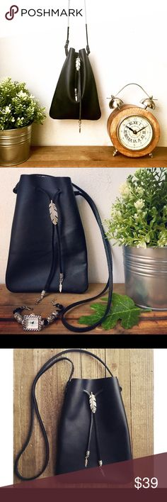 """Drawstring Black Leather bag with silver accents Handmade genuine leather drawstring bag. Carry your phone, sunglasses and other small necessities with casual style.  Details:  100% genuine cowhide                                            Feather slider and feather charm cord ends. Tribal-style silver-plated medallion charm on back. Bag size: 8.5"""" (21.6 cm) long and 6"""" (15.25 cm) wide Total Strap length: approx 34 inches (86 cm). Strap drop is approximately 17.5 inches (44 cm)  Total…"""