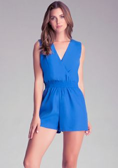 Keep it sexy in our Wrap Front Romper featuring a surplice neckline, smock waist, and a cutout back with button closure. Complete your look with an updo and glossy lip.