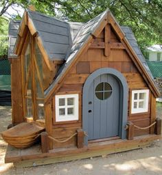 wooden hobbit play house.  Check out the floor-to-ceiling Window on the left side!