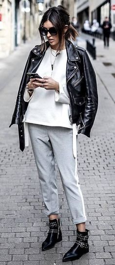 street style inspiration black moto jacket + white sweatshirt + pants + boots