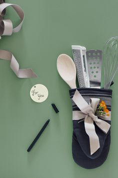 Wrap up some inexpensive baking tools in an oven mitt for a hostess gift that keeps on giving! As a bonus, tuck a couple of your favorite recipes inside. Get more IKEA ideas in our Holiday Prep Guide!