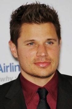 Nick Lachey, 39, has the perfect medium hair style for a round face.  The short cut on the side and long straight up on top makes the face look longer. - 2013 Hairstyles for Men Short Medium Long Hair Styles Haircuts, by Rosie2010