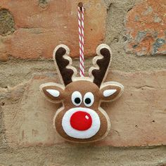 Here is my felt reindeer ornament. He has been made with 100% wool felt and is entirely hand stitched. He measures approximately 4 by 3 1/2 inches. If you have any questions or special requests please dont hesitate to contact me, Melissa xx