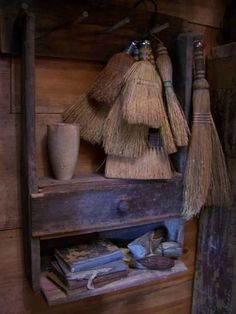 "this is sort of what I want to do with my 5 whisk brooms....I have to think of what else to put on the shelves to sort of go along with the ""cleaning"" idea....old tin from Epson Salts...that type of thing"