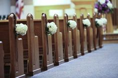Flowers for pews, add soft pink flowers and a dash of green. 1 tall pink and white altar arrangement.