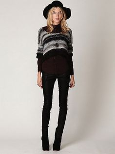 a little more full-length on the sweater but interesting combo of staid collarless button-up and loose sweater.