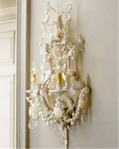 shells glued to chandeliers & wall sconces -- ciao! newport beach: decorating with sea shells