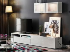 Shown, is $309 (w/o wall cabinets) at IKEA—BESTÅ TV storage combination with shelving units and glass doors.