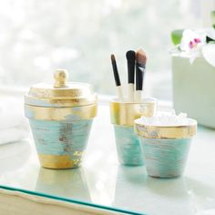 Organize your vanity with this set of gold leaf and turquoise clay pots. --->cute idea