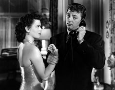 Faith Domergue and Robert Mitchum in a production still from John Farrow's 'Where Danger Lives' (1950)