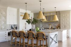 Magnificent kitchen features ivory cabinets painted Benjamin Moore Seapearl paired with Macaubus ...