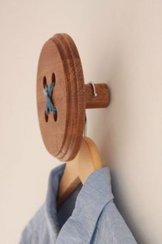 Knopf Knopf haken brown(blue thread) BUTTON WALL-HOOK must make some of these for my craft room and would look great to display individual items from on hangers around a shop display Sewing Room Decor, Sewing Room Organization, My Sewing Room, Craft Room Storage, Sewing Rooms, Coin Couture, Sewing Spaces, Quilting Room, Sewing Studio