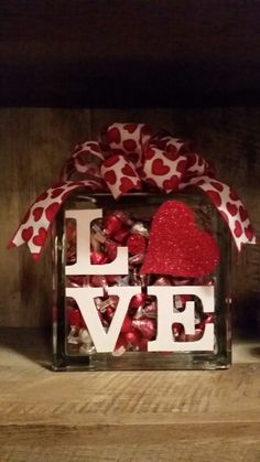 Valentine  Day glass block filled with Hershey kisses.