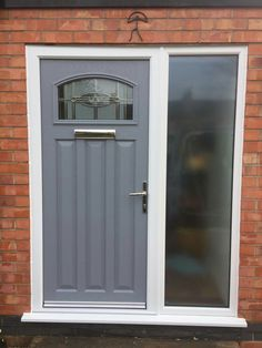 Our Tudor with Reflections glass in Moon dust grey. Composite doors increase your security and homes appearance. They are 19% more thermally efficient than a timber door. www.xtremedoor.co.uk