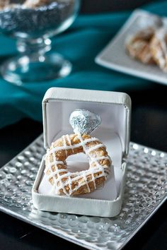 Engagement Ring Rice Krispies w/ Hersey's Kisses. I don't post things like this generally, but it is kind of funny. Great for a shower.