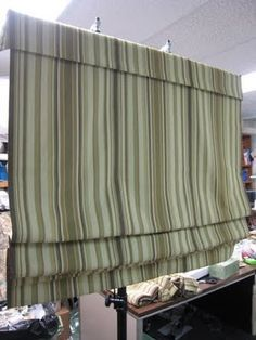 """details on how to make """"cordless"""" roman shade from roller shades."""