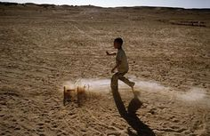 The Saharawi refugee camp Smara..Sahrawi child playing in the desert.January 2008 by Stefano Montesi from the archive buenavistaphoto.it #streetphoto #algeria #refugees #sahara #saharawi #saharadesert...