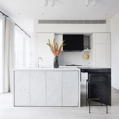 A stunning kitchen featuring Carrara and Pietro Grigio Limestone by . Grey Floorboards, Royal Oak Floors, Tamizo Architects, Crazy Paving, Kitchen Island Bench, Two Tone Kitchen, Internal Courtyard, Banquette Seating, Interior Design Studio