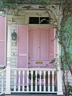 Pink door....not sure if it is me but a beautiful front porch