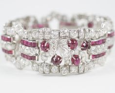 An Impressive Art Deco Ruby & Diamond Bracelet, Platinum. This original Art Deco diamond bracelet is embellished with high quility diamonds, weighing approximately 22 carats, 13 cabachon and square-cut genuine Burma rubies weighing approximately 18 carats. A true beauty from the 1920's. M.L. Brown Inc, New York, USA.
